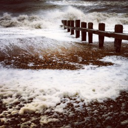 Waves breaking over the groyne